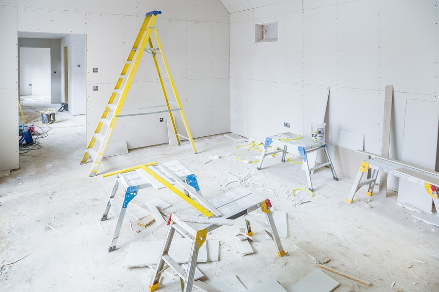 gypsum plasterboard installation in a room interior during a house renovation