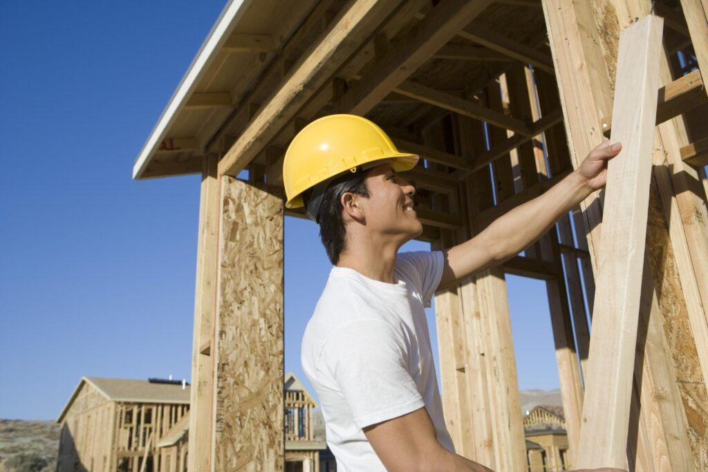 man installing wood wall
