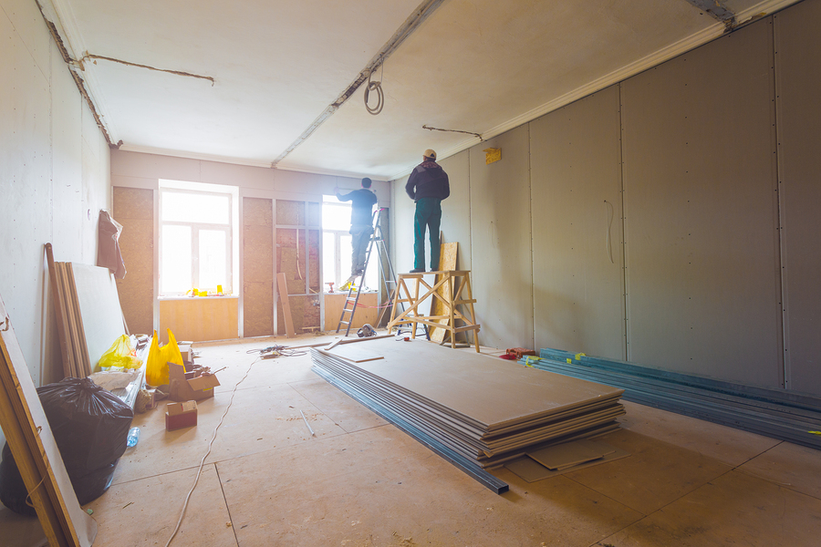 working process of installing metal frames for plasterboard (drywall)